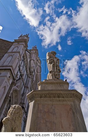 Dante Alighieri monument in front of a Santa Croce basilica and square in Florence