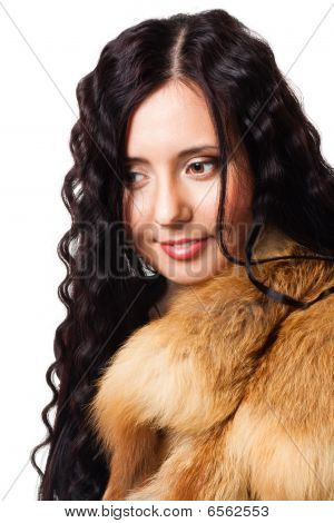 Portrait Of Beautiful Woman With Curly Hair Wearing Fur