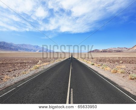 The excellent quality of American roads. Straight as an arrow groomed and smooth the road to dry and wild desert Death Valley