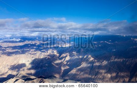 Himalayas mountains aerial view with clouds poster