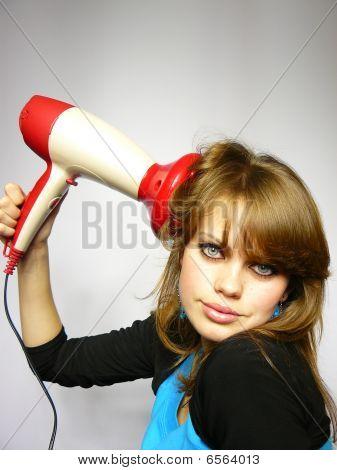 Beautiful Woman Dries Hair The Hair Dryer