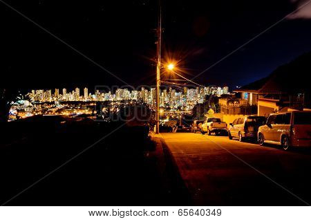 night street view of Honolulu skyline