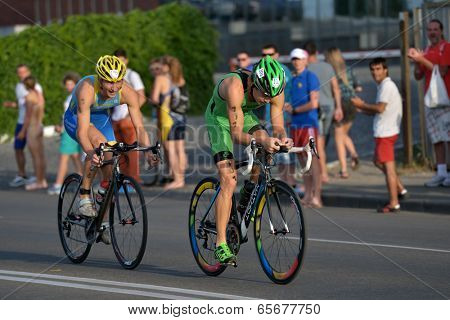 DNEPROPETROVSK, UKRAINE - MAY 24, 2014: Yegor Martynenko (right) and Sergiy Kokhan leading in the second stage of ETU Sprint Triathlon European cup