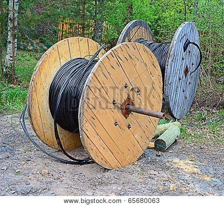 Two Reels Wound By A Cable