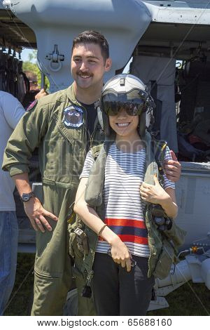 MH-60S helicopter pilot taking picture with spectator during Fleet Week 2014
