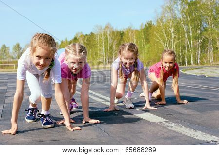 Girls Starting To Run On Track