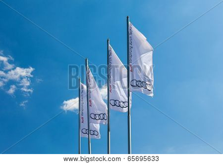 The Flags Of Audi Over Blue Sky.