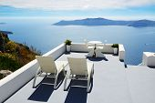 The sea view terrace at luxury hotel Santorini island Greece poster