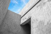 Abstract modern gray concrete architecture fragment with sky poster