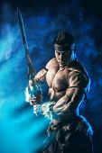 Portrait of a handsome muscular ancient warrior with a sword. poster