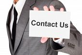 Business contact us card shown in businessman isolated on white background with clipping path poster