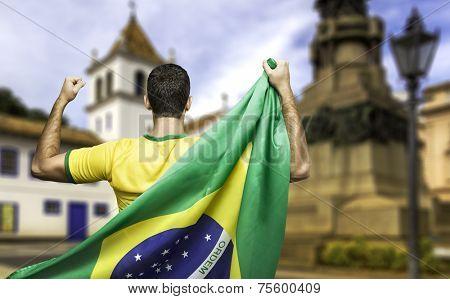 Man holding the brazilian flag in Colegio Square, Sao Paulo, Brazil