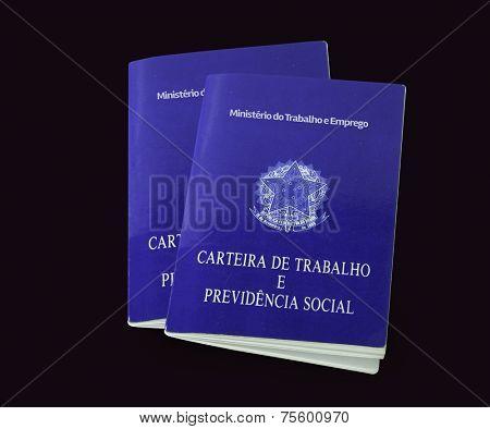 Brazilian document work and social security ( Carteira de Trabalho e Previdencia Social) on black background