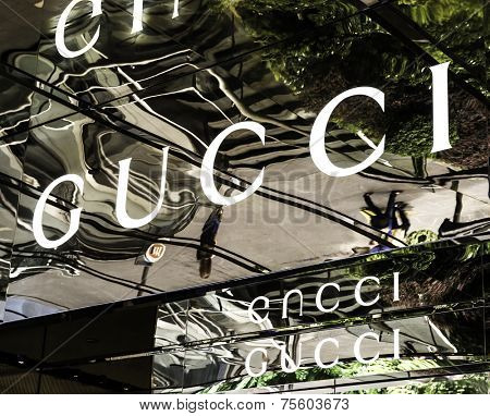 SINGAPORE - CIRCA MARCH 2014: Gucci signage at store entrance. Gucci is an Italian fashion label owned by French company PPR. Gucci was founded by Guccio Gucci in Florence in 1921.