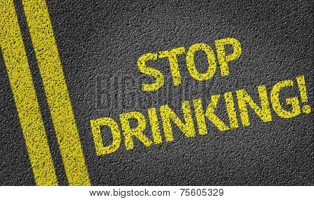 Stop Drinking! written on the road