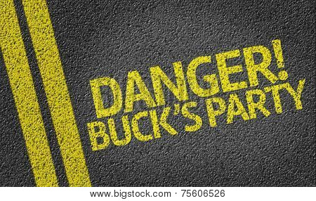 Danger! Buck's Party written on the road