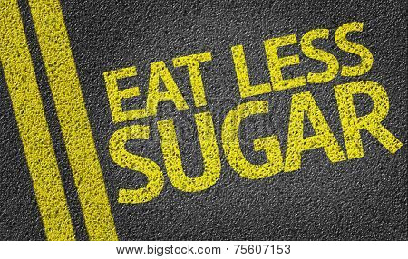 Eat Less Sugar written on the road