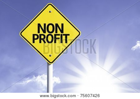 Non Profit road sign with sun background