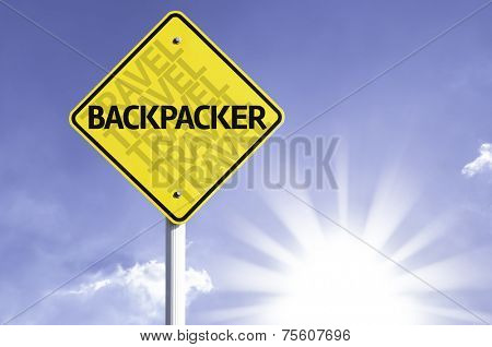Backpacker road sign with sun background