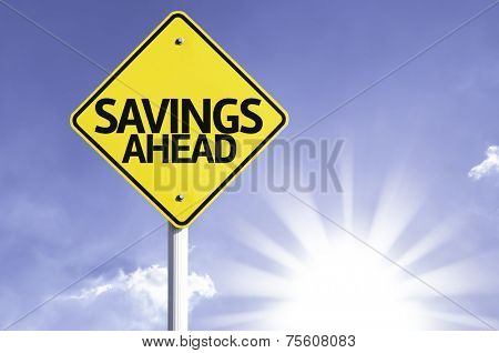Savings Ahead road sign with sun background