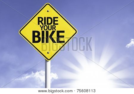 Ride your Bike road sign with sun background  poster
