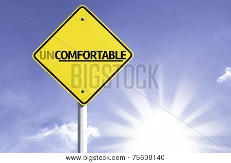 Uncomfortable road sign with sun background