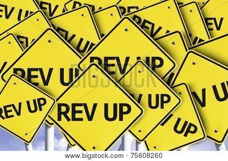 Rev Up written on multiple road sign