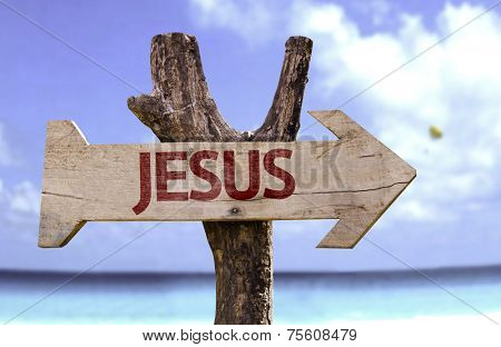 Jesus wooden sign with a beach on background