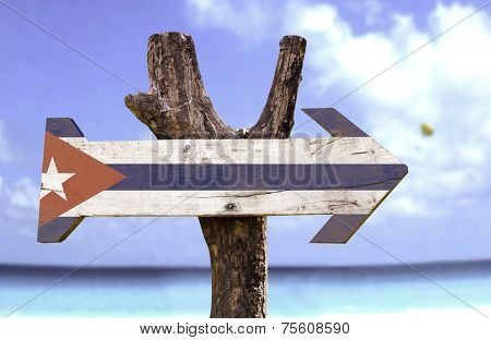 Cuba wooden sign with a beach on background  poster