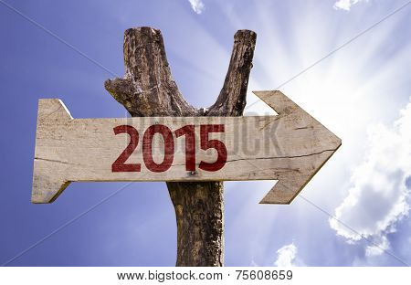 2015 wooden sign on a beautiful day