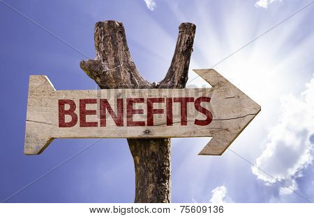 Benefits wooden sign on a beautiful day