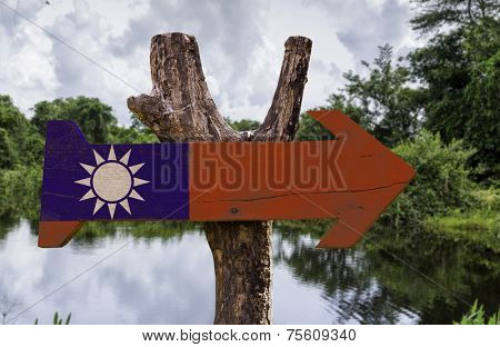 Taiwan wooden sign with a forest on background
