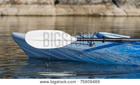 Kayak Paddle With Water Drops Hitting The Lake