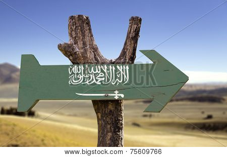 Saudi Arabia wooden sign with a desert background
