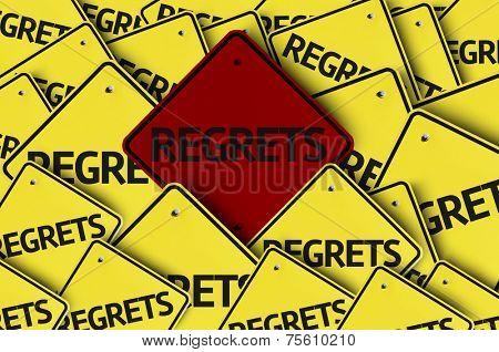 Regrets written on multiple road sign
