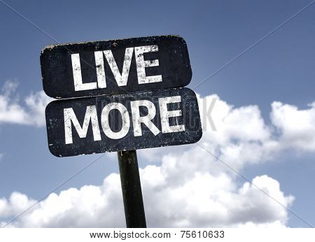 Live More sign with clouds and sky background