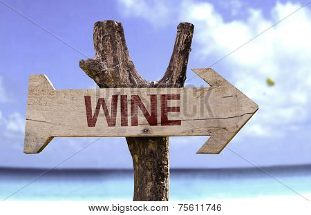 Wine sign with a beach on background