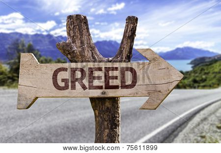 Greed wooden sign with a street on background