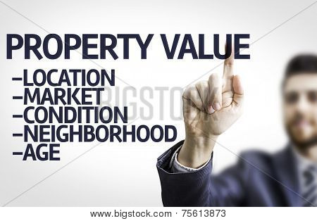 Business man pointing to transparent board with text: Property Value