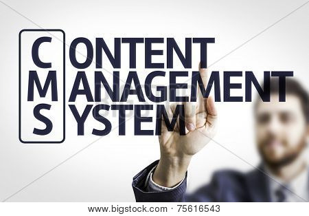 Business man pointing to transparent board with text: Content Management System poster