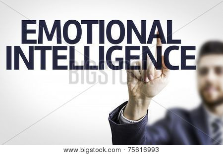 Business man pointing to transparent board with text: Emotional Intelligence