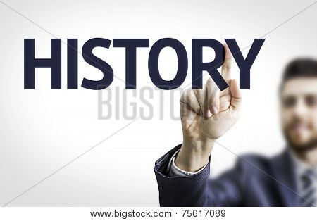 Business man pointing to transparent board with text: History