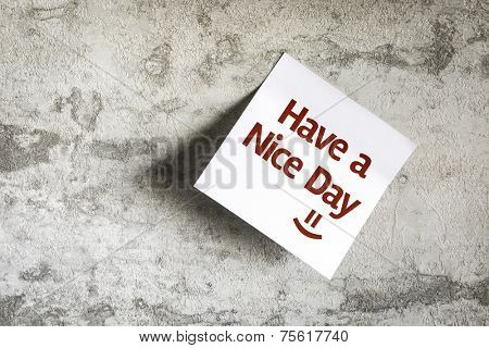 Have a Nice Day on Paper Note on texture background