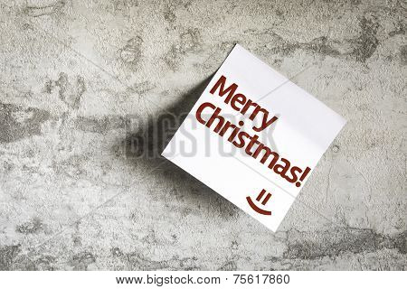 Merry Christmas on Paper Note on texture background