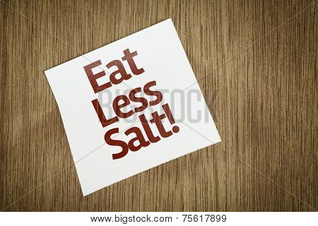 Eat Less Salt on Paper Note with texture background