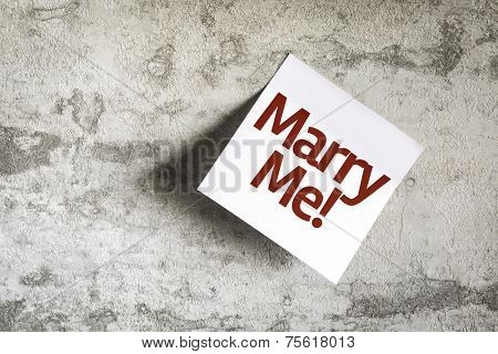 Marry Me! on Paper Note on texture background