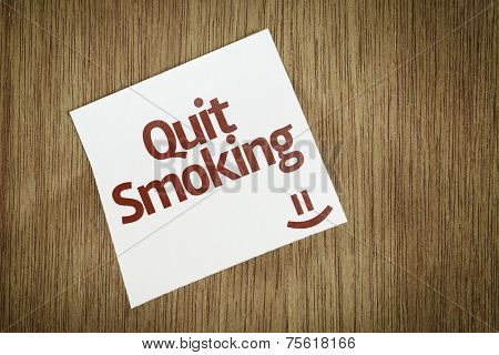 Quit Smoking on Paper Note on sky background