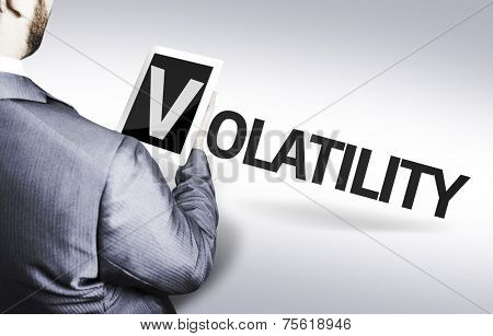 Business man with the text Volatility in a concept image