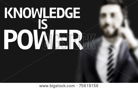 Business man with the text Knowledge is Power in a concept image poster