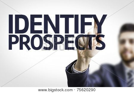 Business man pointing to transparent board with text: Identify Prospects